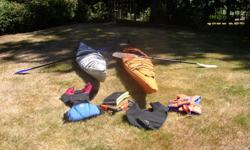 two ocean kayaks with all accessories - (1) Current Design Storm 17ft. - (1) Necky Narpa 17ft.