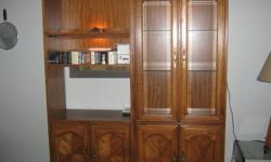 for sale 2 very nice cabinets, they both have lights in them. one has glass doors and adjustabe glass shelves and 2 doors on the bottom with 1 adjustable shelf. the glass shelves are made to display plates. there are 3 shelves. the other cabinet is the