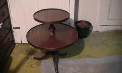 2 Tiered wooden table for sale age unknown can be used as an occasional table, coffee table, or side table. contact with offers