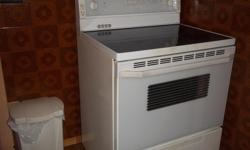 aprox. 12 yrs old but works awesome... replaced oven burner about a yr. ago... moving so must sell