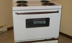 """30"""" electric stove  white in color  excellent working condition  $100.00  call Pam 565-3644 after 4:30 pm"""