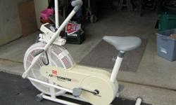 Stationary exercise bike, big seat, in excellent condition