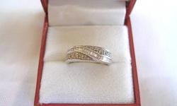 Twenty five Diamond baguettes set through ten round Diamonds, .33 carat total, on a 14k White Gold Journey ring. Clarity- SI2, SI3. Color- H, I. Size- 6 3/4. Brand new. **see all of our listings (above email response box), we deliver.