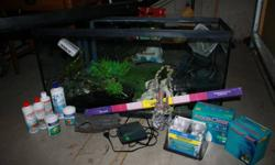 33 gallon fish tank Includes: canopy, extra light bulb, heater, air pump & air lines, undergravel cleaner, magnatic glass cleaner, 2 ornamental stumps, ornamental castle, various ornamental plants, fish net, 2 different typ...es of food for tropical fish,