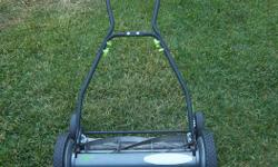"""""""Earth Mower"""" 18"""" push mower for sale. Good on the environment. Adjustable height of cut. Only $75. NOW $50. We are located in Orleans. See our list of other items for sale. First come, first served."""
