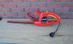 """Homelite 17"""" electric hedge trimmer for sale. Only $30. We are located in Orleans. See our list of other items for sale. First come, first served."""