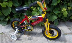 """""""Monster Bike"""" by Tonka bike for sale. 12"""" wheels. Training wheels. Only $40. We are located in Orleans. See our list of other items for sale. First come, first served."""
