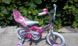 """""""True Princess"""" by Huffy bike for sale. 12 1/2"""" wheels. Training wheels. Heart shaped pedals. Doll carrier and bell. Very cute bicycle. Only $50. We are located in Orleans. See our list of other items for sale. First come, first served."""