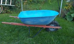 """Yard Works"" wheelbarrow for sale. Tub size is 27"" wide X 39"" long X 16"" deep at front of tub. Wood handles. Heavy duty metal tub. Very sturdy. Only $65. Now $60. We are located in Orleans. See our list of other items for sale. First come, first served."