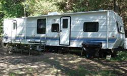 Great Family trailer. 3 bunks at one end and queen size bed at the other. bath tub and shower new awning 2011 well maintained Please call or email for more info 9500.00 Price will increase April 1st