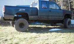 offset six bolt black chevy rims (new) on 35 inch swampers with over 50% still on them. tires are balanced. i rode them on 401 couple of times first 700 takes em. im looking for 39 inch swampers on offset rims for same truck (88-98) txt only joe 705 868
