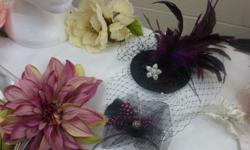Handmade and custom orders for floral and lace hair clips, birdcage veils, vintage lace clutch purses, feather fascinators and an array of lovely accessories for your wedding or special occasion..