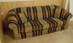 Warm, comfy chesterfield in good condition.   See our other ads (more coming) for dining room suites, kitchen set, antiques, table lamps, pair f  chairs, glider, rocker,