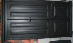 Antiqued solid wood armoire, can be used for TV or also has shleves to use as a clothing armoire...doors bifold back