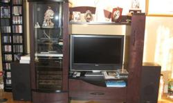 Beautiful wall unit, black and Aubergine color, in 3 sections, will accept a 32 inches T.V.
