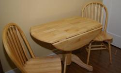 """Round, 40"""" drop leaf table and 2 matching chairs Excellent condition; asking $150 obo Email for contact information"""