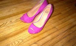 Beauty shoes, only wore them one time with a specific outfit. Soft faux-suede is magenta on the body with red and yellow details. Thick super-high heed and platform at front. These are beauty! The only evidence of wear is on the soles. Originally these