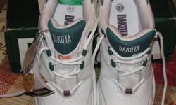 Selling for $40.00.New-Never worn. White running shoe style safety work shoes. CSA Approved.Women's size 8 1/2 Wide Steel toes Puncture/Shock resistant steel soles. Resists heat, oil, and acids. White leather with green trim. I bought these and never