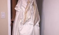 Ivory colour with Beige sash and beading. High quality satin material. Very soft, light and flexible to move around In during your special day! Worn 1 time in Alberta and was bought new at over $3000 and was professionally cleaned afterward (another