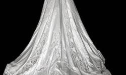 Have beautiful size 8-10 wedding gown for sale. Fits more like a size 6-8. (Prestige A-line princess style) with 5' train, intriciate beading on bodice with scalloped v-neck, sleeves and skirt/train, made of silk and taffeta. Has sewn in crenoline and