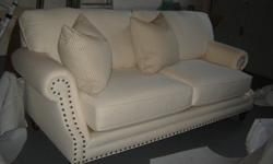 Brand new off white couch - very modern in a lovely fabric material.