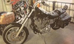 AVAILABLE IMMEDIATELY: Black 1988 Harley Davidson 883 Sportster. Modified gas tank. Leather soft-side saddle bags. Great condition, minor signs of aging. Runs well. Needs front and rear signal lights (wiring in place, only requires hookup) and possibly a