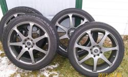 4 evo 7 custom rims with performance tires. rims in excellent condition no curb rash. well taken care of , never seen salt. wheel rings and theft proof chrome lugs included. color- gun metal. universal fit. 4x100 and 4x114.3   off of my 04 saturn ion