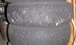 4 Good year   Ultra grip tires  size  215 /70 /15  --  50 %  tread  left