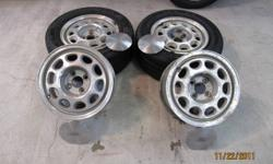 """4 late 80's mustang rims with center caps 4 hole 15 """" dia. ( tires are no good )"""