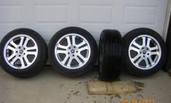 4 mustang tires and rims 90% tread Tires alone cost over 1200.00 5 hole pattern.