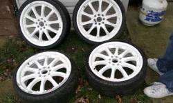I've 4 universal rims with 215/35R16 low pro rubber. 2 are new and 2 are 80%.