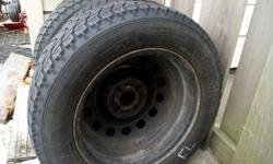 I have four slightly used snow tires with rims.  They came off a Ford Focus..however they did not fit my focus wagon (2002). Still have good amount of tread and rims in good shape.  OBSERVE G-02 185/65R14 86T microbit compound studless pick up only