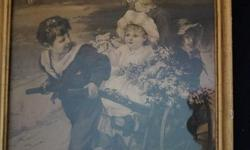 If the item is listed it is still for sale. It is removed immediately when sold. This whimsical antique print is of a boy pulling 3 girls in a cart. The print is not in perfect condition and shows a tear on close inspection, The frame has the original