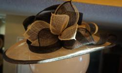 If the item is listed it is still for sale. It is removed immediately when sold. This hat is lovely with bold floral style. It is black and beige. It is 16 inches wide and 7 1/4 inch across opening. Please check out ALL my listings by simply clicking on: