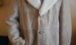 If the item is listed it is still for sale. It is removed immediately when sold. This mens coat looks new never worn and is in mint condition. It is lambskin with a shearling sheared collar. Not sure of the size but is 21 inches from shoulder to shoulder
