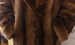 If the item is listed it is still for sale. It is removed immediately when sold. This stylish vintage fur coat is thick and comfy with a large collar. The sleeves are cuffed and can be lengthened or shortened to desired length. The coat is about a size