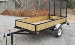 "New 4x8 trailer, 3"" channel frame, 2"" coupler, 3/4 pt deck and sides, 5' folding ramp tailgate, 4-1000lb tie downs, 12"" tires, 2100 lb axle. located in New Liskeard, 705-648-0303"