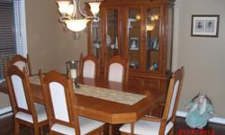 DINING ROOM TABLE, LEAF FOR EXTENSION, 6 CHAIRS TWO WITH ARMS, HUTCH WITH LIGHT, BUFFET WITH DRAWER FOR SILVERWARE. MUST BE PICKED UP IN EVERETT,PRICE SHOULD READ $500
