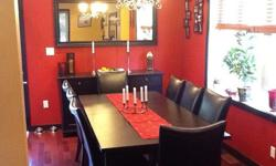 """- Table seats 8, plus two insert leaves to sit 10 or 12. Plus 8 """"faux"""" leather Brogan chairs.Approximately 1 year old. Table initially cost $399.00 and chairs were $129.00/each for a total initial value of over $1400.00. All pieces are in excellent"""