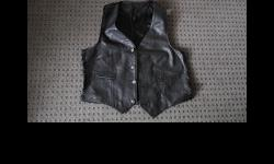 Made in Italy this vintage vest is a great find, made in the mid 80?s. Front fob pockets, soft Italian leather with cloth backing for comfort under suit jacket. 4 star brass button snaps. European styling & sizing. size 48 Pick-Up Only