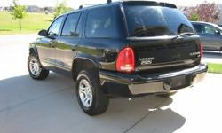 2003 Dodge Durango SLT 4x47 PassengerFully Loaded with Pwr Windows, Pwr Locks, Pwr Brakes, Pwr Steering, Pwr Seats, keyless entry, new tires, new brakes, A/C, Tilt, Cruise, Dual Climate Control, Roof Rack & More!Clean SUV, Runs and Drives Great!Only