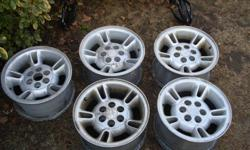 i am selling 5 aluminum rims (spare included). they are 15 inch rims with a six bolt pattern. they are in great condition just need to be cleaned up, no damage. they have dodge ram center caps but they can be very easily popped out and used on any 6 bolt