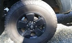 LT 285/70R17 tires taken off of a 2015 Toyota tacoma. Four tires have about 30000km on them, maybe about 70% tread left on them and one tire is a spare so it is brand new, never used. I have a quote from cedar tire for 4 brand new tires totaling $1800