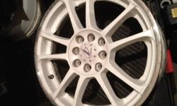 """Selling a set of WHITE 16 x 7 in rims off my integra, no tires. Pictures show what they look like. Very good condition, don't have the car anymore so don't need them. 4x100 and 4x114.3 bolt patterns, +44 offset (Actual complete rim width is 8"""" and from"""