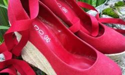 Gently used. Size 7. Red Espadrille. Can be worn with or without ribbon. Original box can be included.