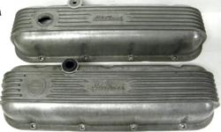 Vintage Edelbrock BB Chevy Early Alum Finned Valve Covers with Chevrolet emblem, Natural finish , Dripper & back end of one cover is trimmed down. # 4180 $275.