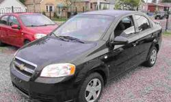 """ALL INCLUDED! SAFETY & E-TEST & CAR-PROOF & FACTORY WARRANTY. NO HIDDEN CHARGES, JUST + TAX!? 2007 CHEVROLET AVEO LS., Automatic, 4drs Sedan, AIR CONDITIONER, CD/MP3, Tilt, 1.6Liter, Black. ONLY: 67,000 kilometers. DIRECT FROM GM CANADA SALE: $6,699"
