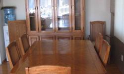 Dining room table set for sale with 6 chairs a buffet hutch and extra leaf for table. Oak inlays on the table and hutch+buffet. 4 regular chairs and 2 armchairs. In mint condition, well taken care of. Hutch also has built in lighting. buffet and hutch: