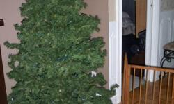 Hi there,   I have a 6' foot Christmas Tree for sale with clear lights wrapped around it with a stand. Received a new tree as a gift and do not need this one. Please contact me by e-mail, serious inquiries only! Need it gone ASAP ad will be removed once