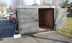 6'x12' closed utility trailer with jack and wiring.  In excellent condition